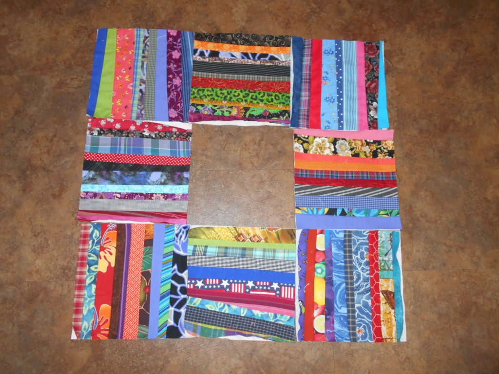 8 string quilt blocks done in a variety of colors