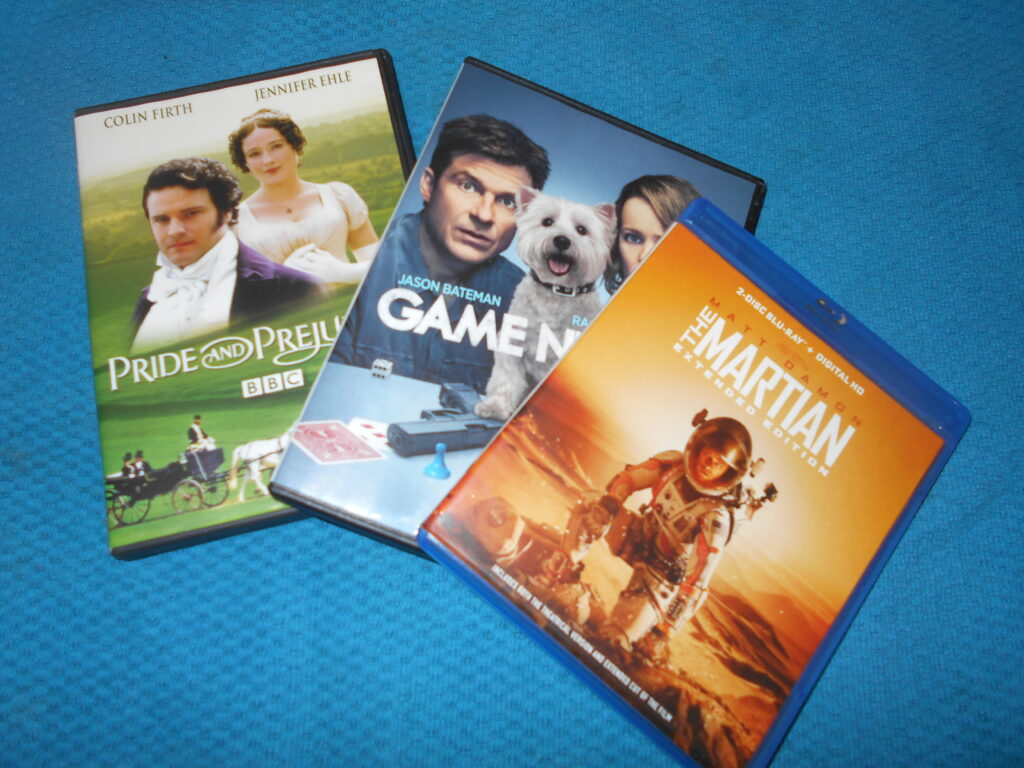 A display of three DVD cases: Pride and Prejudice, Game Night, The Martian.